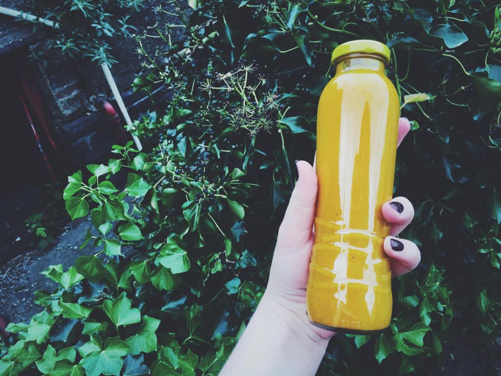 turmeric ginger lemon shot vegan home made reused glass bottle
